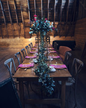 Table rental from Rouge Rustic Rentals with decor by Tara's Designs & Florals by Purple Orchid Flowers