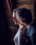 bride & groom portrait in loft at Ackerhurst Dairy Farm in Bennington, Nebraska