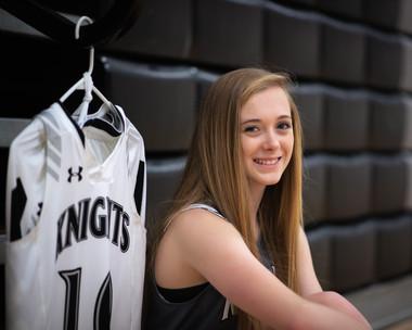 senior girl basketball player posing in gym at Murdock, NE