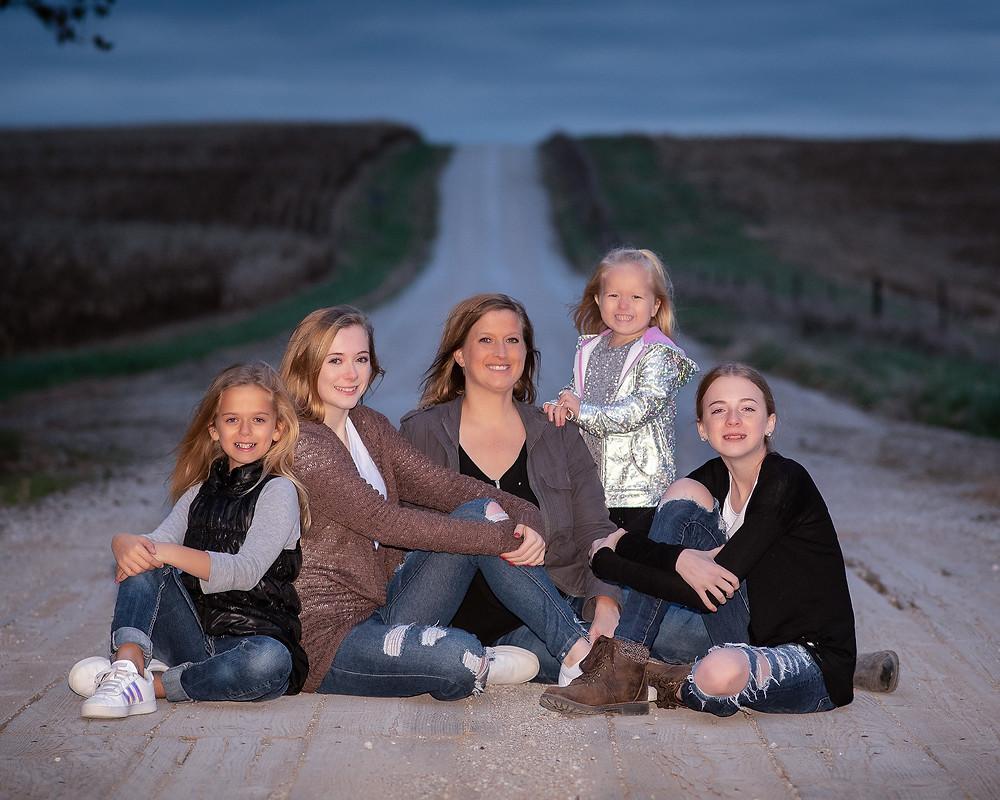 family portrait on rustic bride dirt road in Gretna, Nebraska