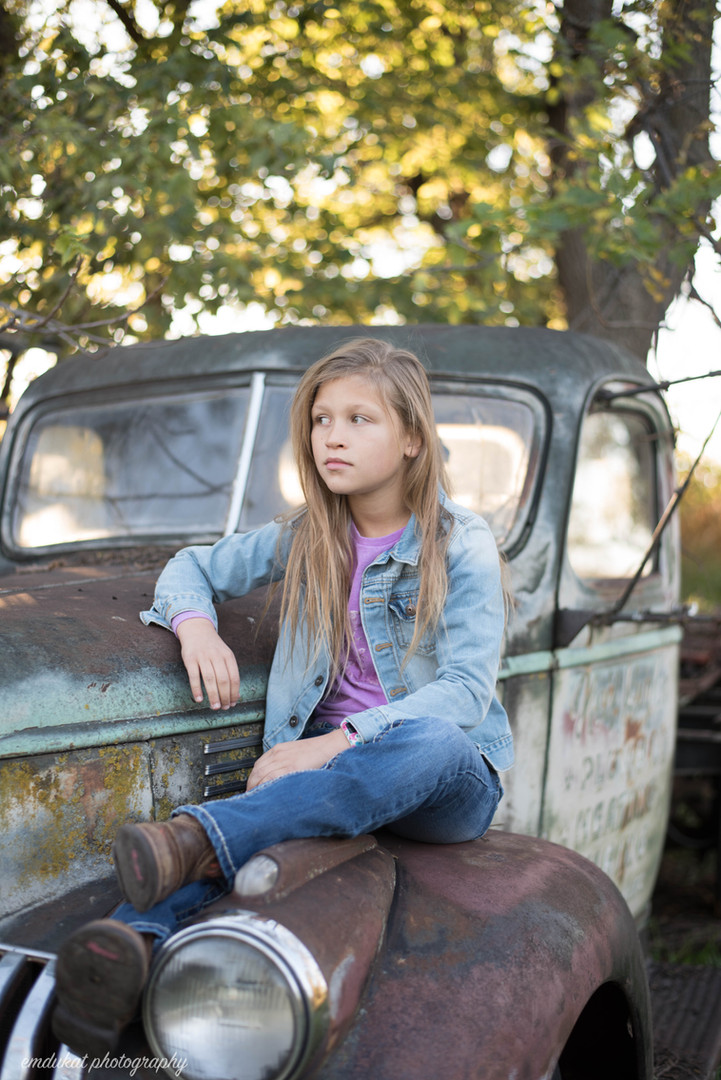 girl-on-antique-rustic-truck-family-photographer-nebraska