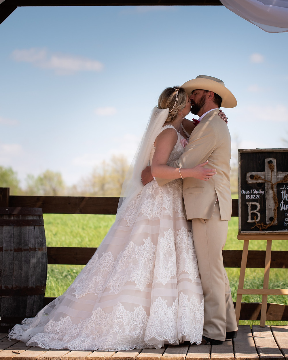 Shelby & Chris Blatter share their first kiss as husband & wife at their Roca Berry Farm wedding