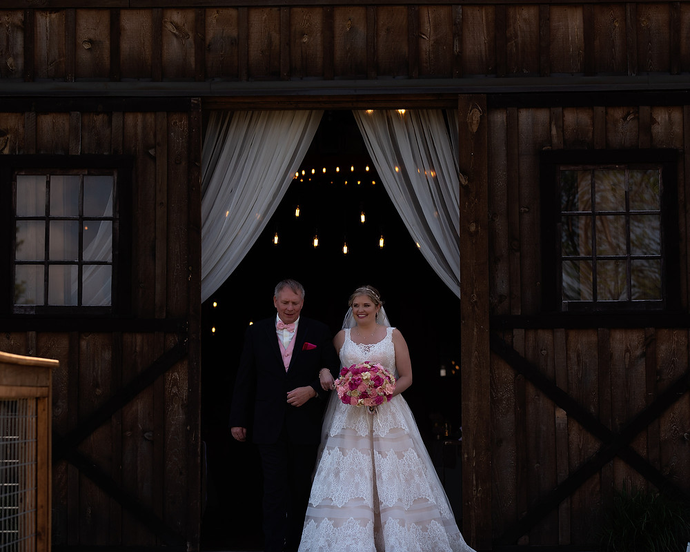 Shelby & her dad exiting the Pioneer Barn for the ceremony at Roca Berry Farm in Nebraska