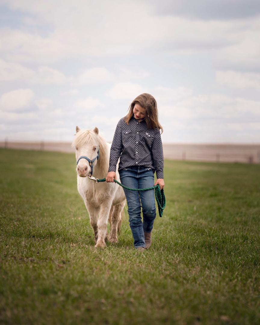 child-pony-field-gretna-nebraska-equine-photographer