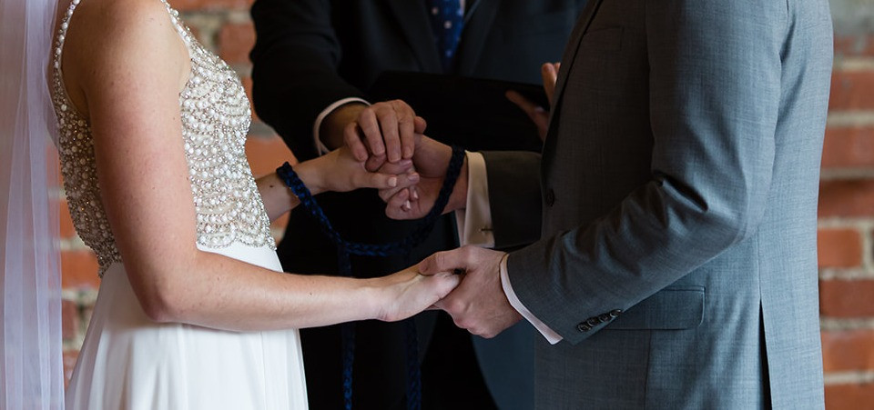 Handfasting ceremony at Cross + Main in Youngsville, NC