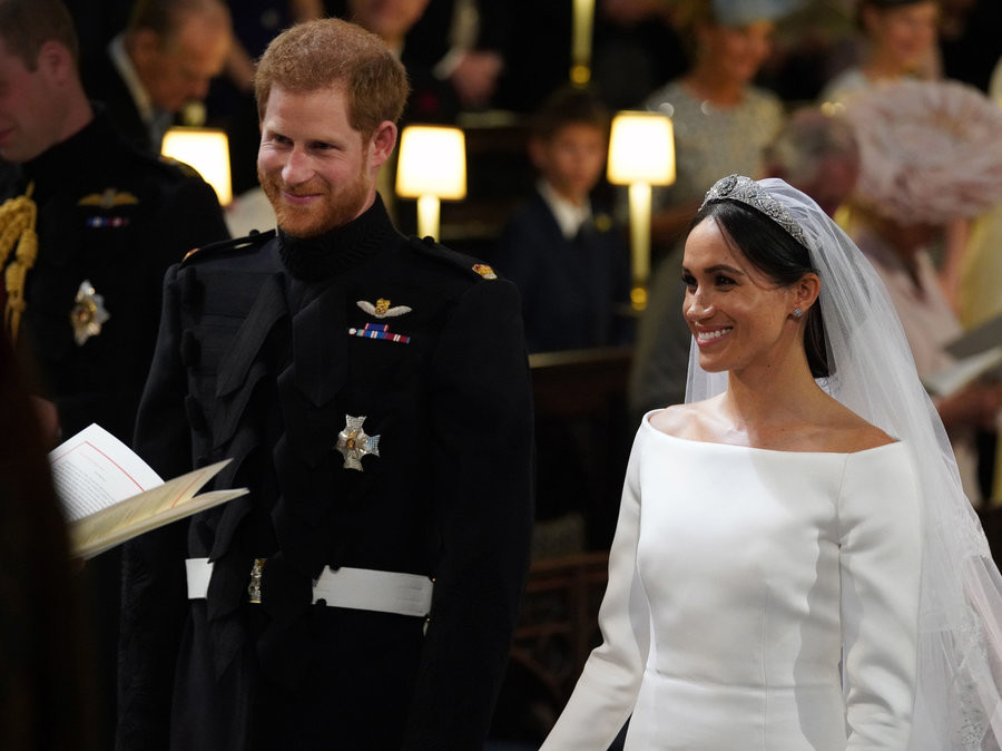 Prince Harry and Meghan Markle prepare to exchange vows.