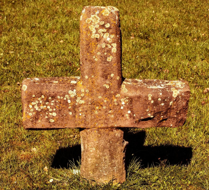 Public domain photo of a cross in the ground.