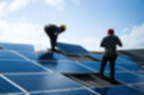 Installing a Solar Cell on a Roof.jpg