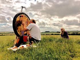 Playing the gong at Avebury