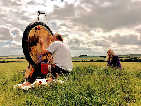 Playing the gong at Avebury