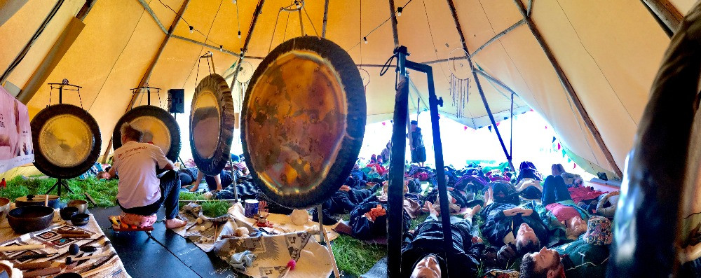 Picture of Paul Dane GongSpace playing large Gongs at Soul Circus Festival Sound Healing Tent 2019