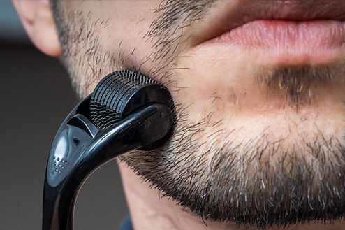 Facial hair care concept. Young man is u