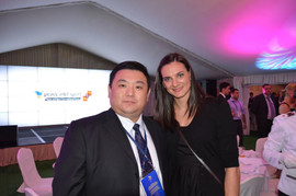 Xiaomu Feng with Elaine Isinbayeva, the world record holder of women's pole vault