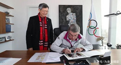 Jiannan Huang, International Olympic Committee (IOC) President Thomas Bach3043