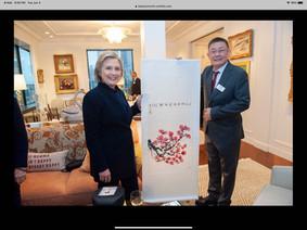 Hillary Clinton with Guixun Xu