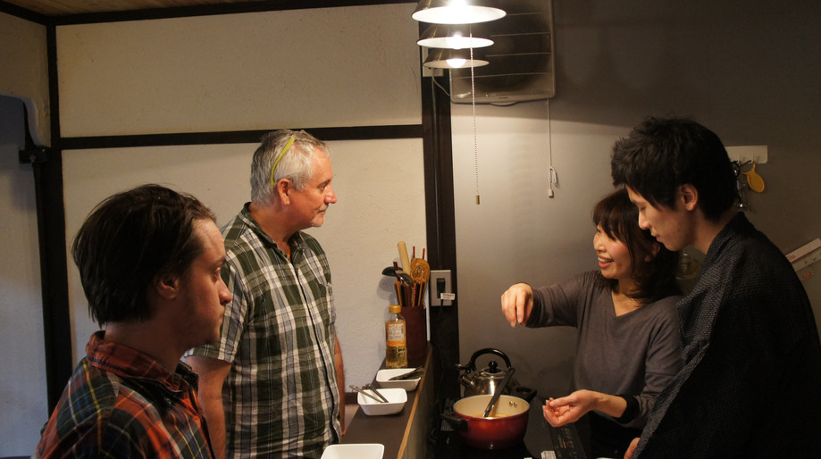 cooking class participants learning Japanese cooking