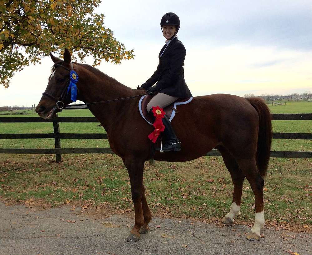Roxann Sommers and Mr. Mugs show off their 1st and 2nd place rosettes.