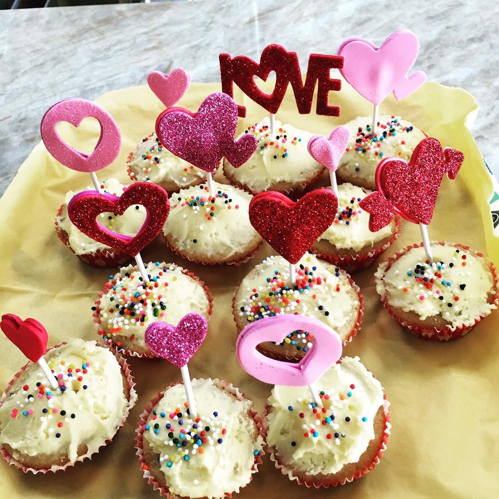 Mini pink cupcakes with rainbow sprinkles
