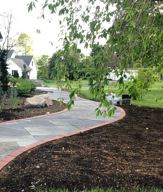 Ruth Consoli Design: natural sandstone walkway with brick edging installed by Living Landesign, Inc.