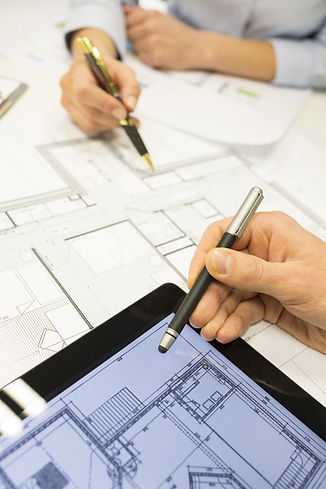 Close-up of Team architects working on c