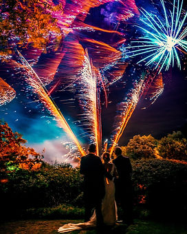 uk reportage wedding photography, documentary wedding photographer, ceremony, amazing wedding dress, weddings by martin sylvester, london wedding photography, barnsdale hall, fireworks with bride and groom