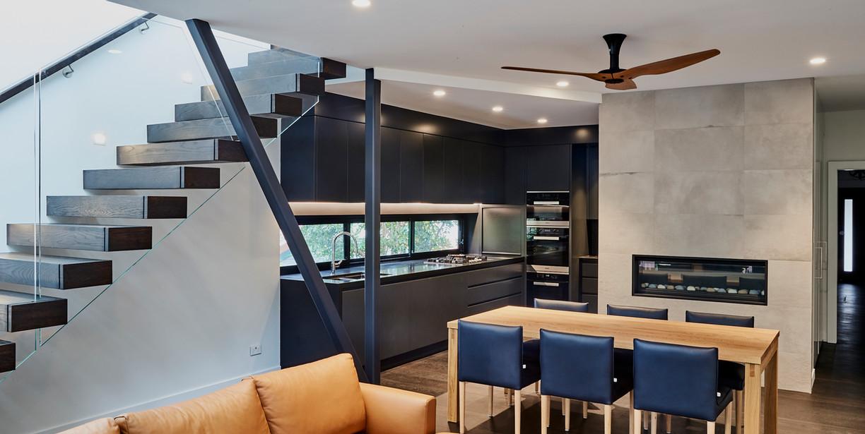 4. Diagonal view of stairs, dining, kitc