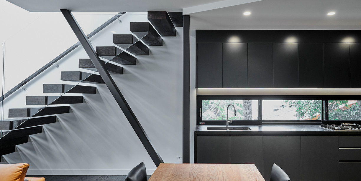 3. Side view of stairs and kitchen.jpg