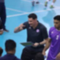 Luciano coaching during game with young