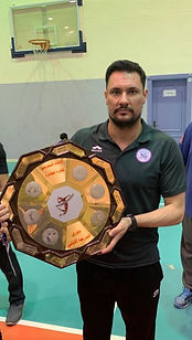 Luciano with huge plaque.jpeg
