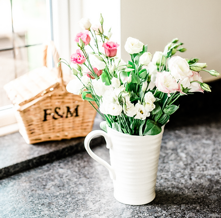 Flowers in white jug F&M hamper.png