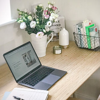 Organised desk with flowers working from home