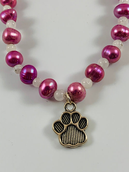 Magenta freshwater pearl stretchy bracelet with paw print charm