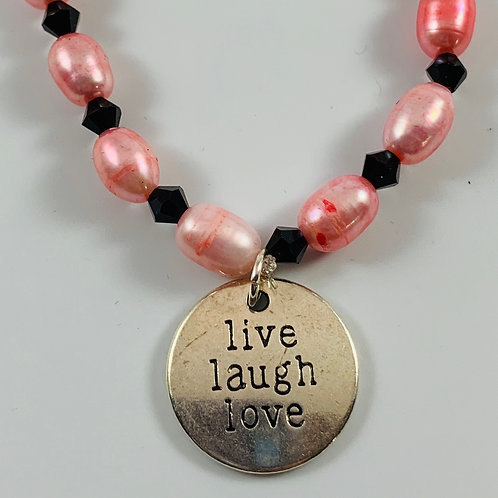 Pink freshwater pearls with live laugh love charm