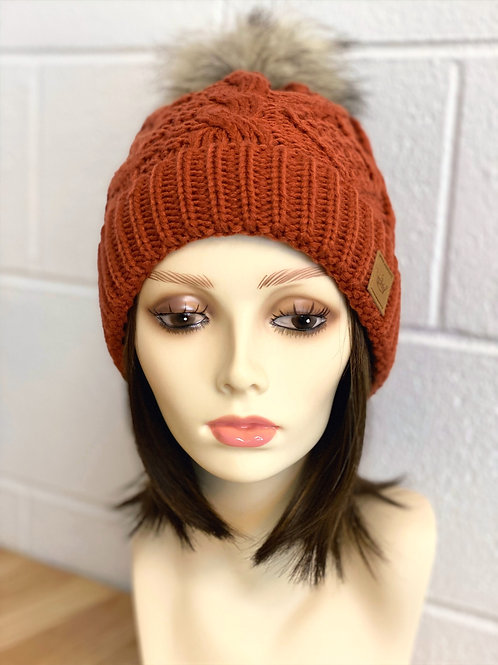Burnt Orange fleece lined cable knit hat with pom pom accent
