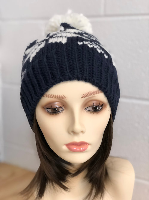 Navy blue with white snowflake fleece lined cable knit hat with pom pom accent
