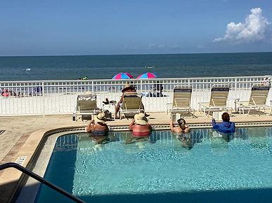 reading in the pool.jpg