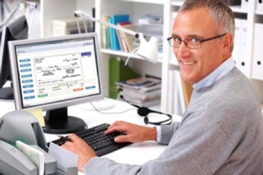 man sitting in front of computer