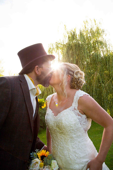 Kissing with sun flare