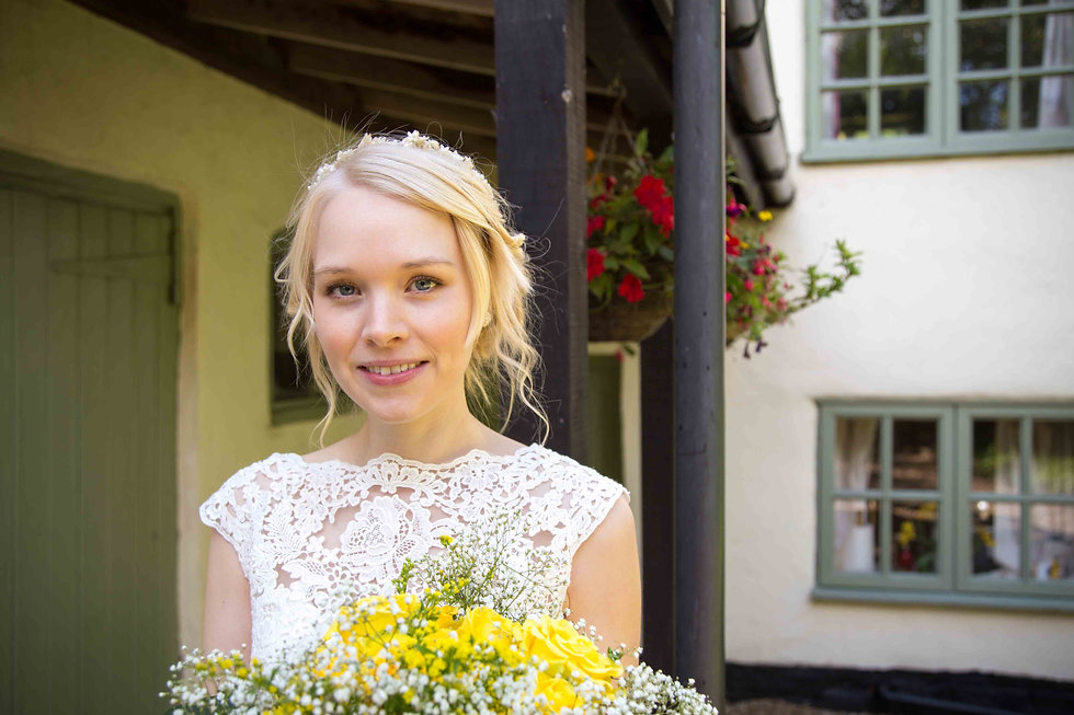 Norfolk bride with flowers before departing for the church and then on to there reception at The Reading Room venue.