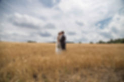 The bride and groom in corn feild