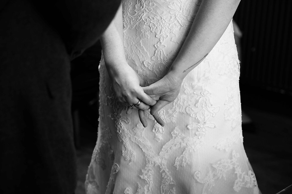 The brides fingers, restless with love.