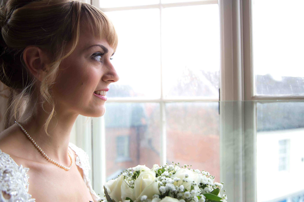 The bride looking out of window