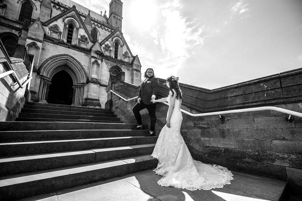 Bride and groom walking up steps, very romantic image.