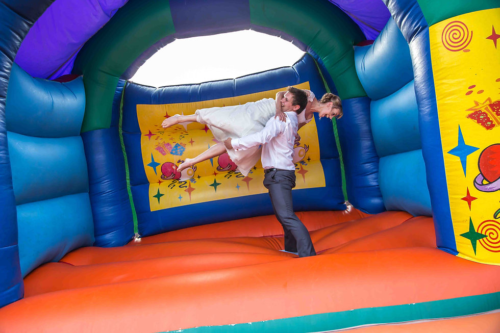 The bride being lifted on bouncy castle