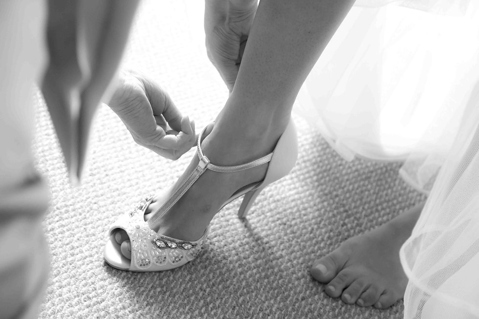 The bride putting her shoes on