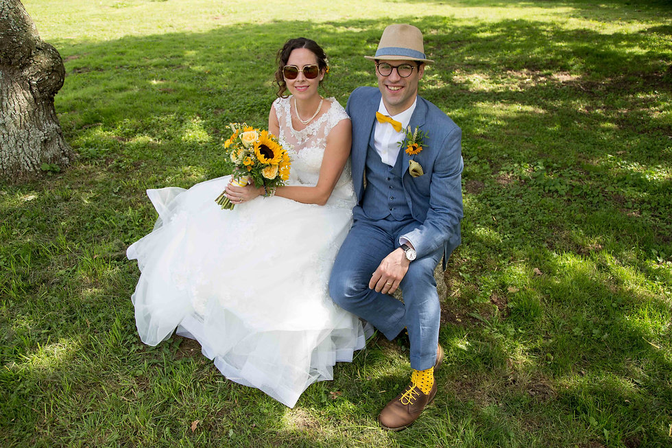 Bride and Groom sitting on a stone