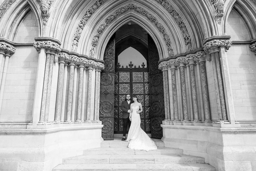 Ouside the Roman Cathedral off Unthank road with bride and groom looking very cool.