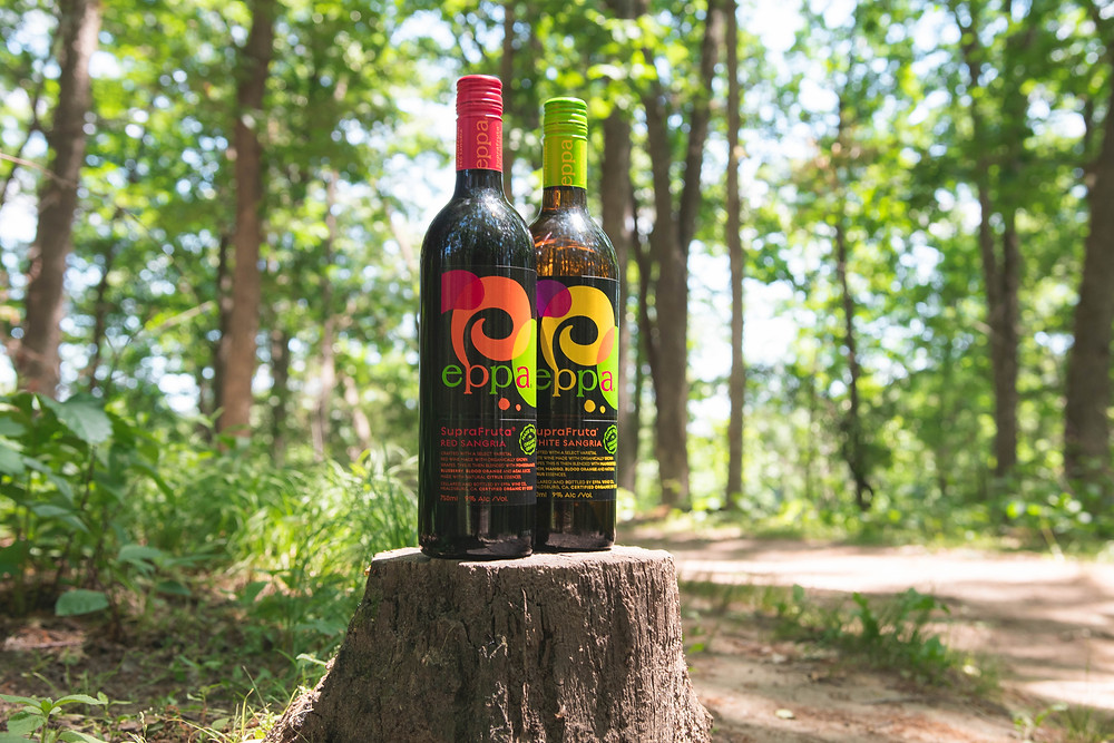 Eppa SupraFruta Sangria on a tree stump in a forest