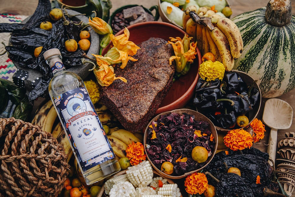 Pechuga Mezcal surrounded by meat and spices
