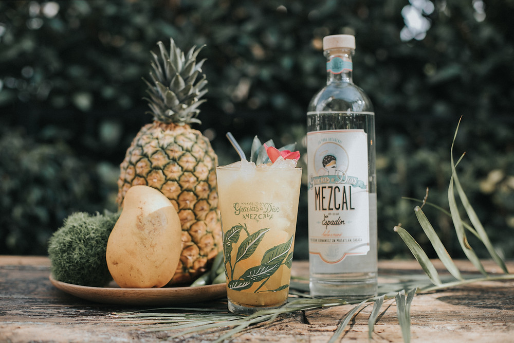 Fruit and Mezcal mixed together to form a cocktail